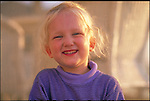 portrait of laughing young girl on porch