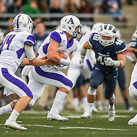 8 October 2016: Amherst College Purple & White Wide Running Back Nick Kelly, a Senior from Westport, CT, takes a handoff and rushes for yardage against the Middlebury College Panthers at Alumni Stadium in Middlebury, Vermont. The Panthers edged out the Purple & While 27-26. Mandatory Credit: Ed Wolfstein Photo *** RAW (NEF) Image File Available ***
