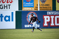 Visalia Rawhide left fielder Luis Silverio (15) pursues a fly ball during a California League game against the Lancaster JetHawks at The Hangar on May 17, 2018 in Lancaster, California. Lancaster defeated Visalia 11-9. (Zachary Lucy/Four Seam Images)
