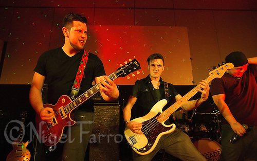 10 Jan 2015 - STOWMARKET, GBR - Renegade Twelve's lead guitarist Dan Potter and Josh Barnard on bass guitar perform at the John Peel Centre for Creative Arts in Stowmarket, Suffolk, Great Britain (PHOTO COPYRIGHT © 2015 NIGEL FARROW, ALL RIGHTS RESERVED)
