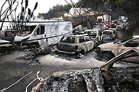 Pictured: Rows of burned cars in the Mati area, Kokkino Limanaki near Rafina, Greece. Tuesday 24 July 2018<br /> Re: Deaths caused by wild forest fires throughout Greece.