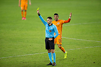 CARSON, CA - OCTOBER 28: Referee Ramy Touchan displays yellow during a game between Houston Dynamo and Los Angeles FC at Banc of California Stadium on October 28, 2020 in Carson, California.