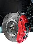 Closeup of Lamborghini sports car front ceramic brakes, a disc and a caliper Image © MaximImages, License at https://www.maximimages.com