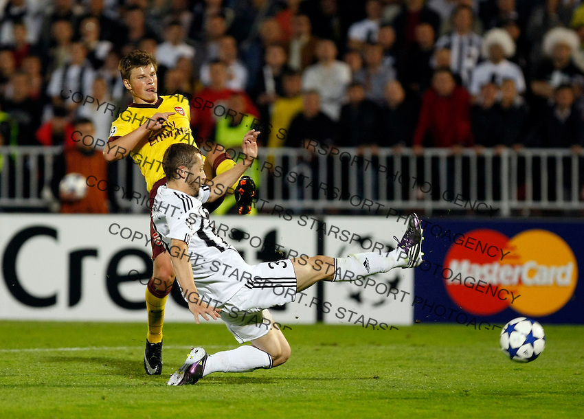 Arsenal player Andrey Arshavin, left shoot at goal near Partizan player Ivan Stevanovic,  during  UEFA Champions league match in group H FC Partizan Belgrade Vs. Arsenal, London, Serbia, Monday, Sept. 28, 2010.  (Srdjan Stevanovic/Starsportphoto.com)