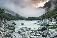 Moody scene at Lake Mackenzie on Routeburn Track with exposed rocks, Fiordland National Park, Southland, South Island, UNESCO World Heritage Area, New Zealand, NZ