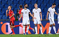 6th August 2020, Basel, Switzerland. UEFA National League football, Switzerland versus Germany; Ilkay Guendogan, Matthias Ginter and Niklas Suele  discuss how Switzerland scored their goal