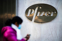 NEW YORK, NY - NOVEMBER 18:  A woman walks in front of Pfizer headquarters on November 18, 2020 in New York. The drug maker company Pfizer inform that its Covid-19 vaccine is  95 percent effective with no serious side effects while Coronavirus cases skyrocket around the globe. (Photo by Eduardo MunozAlvarez/VIEWpress)