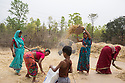 India - Jharkhand - Dhab - Villagers separating the wheat from the straw with the help of the fan.