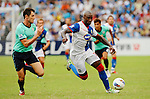 SO KON PO, HONG KONG - JULY 30: Jason Roberts of Blackburn Rovers and Fernando Recio Comi of Kitchee in action during the Asia Trophy pre-season friendly match at the Hong Kong Stadium on July 30, 2011 in So Kon Po, Hong Kong.  Photo by Victor Fraile / The Power of Sport Images