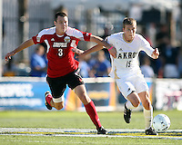 Scott Caldwell #15 of the University of Akron pushes away from Paolo DelPiccolo #3 of the University of Louisville during the 2010 College Cup final at Harder Stadium, on December 12 2010, in Santa Barbara, California.Akron champions, 1-0.
