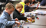 Adolfas Stankus, left, and Trenton Thompson, both 9, play at the Lego Club event at the Carson City Library, in Carson City, Nev., on Saturday, Dec. 17, 2011. .Photo by Cathleen Allison
