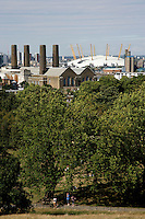 The O2 Arena, formerly the Millennium Dome, and xxxxxxx power station in east Greenwich seen from Greenwich Park, London, UK