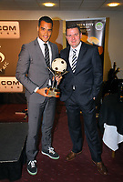 Pictured L-R: Goalkeeper Michel Vorm receiving the Supporters' Player of The Year award by Gareth Vincent sports reporter for the Evening Post. Thursday 10 May 2012<br /> Re: Swansea City FC awards dinner at the Liberty Stadium.