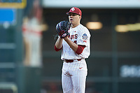 Oklahoma Sooners starting pitcher Cade Cavalli (24) looks to his catcher for the sign against the Arkansas Razorbacks in game two of the 2020 Shriners Hospitals for Children College Classic at Minute Maid Park on February 28, 2020 in Houston, Texas. The Sooners defeated the Razorbacks 6-3. (Brian Westerholt/Four Seam Images)