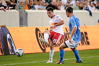 Matt Kassel (15) of the New York Red Bulls passes the ball under pressure from Josiah Snelgrove (3) of FC New York. The New York Red Bulls defeated FC New York 2-1 during a third round match of the 2011 Lamar Hunt US Open Cup at Red Bull Arena in Harrison, NJ, on June 28, 2011.