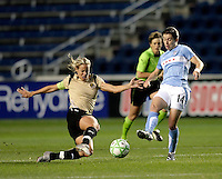 FC Gold Pride midfielder Leslie Osborne (10) slide tackles the ball away from Chicago Red Star forward Karen Carney (14).  The defeated the FC Gold Pride defeated the Chicago Red Stars 1-0 at Toyota Park in Bridgeview, IL on May 16, 2009.