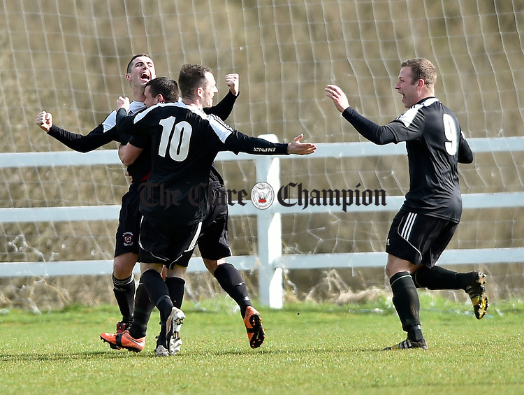 Janesboro players celebrate their winning goal against Newmarket Celtic during their Munster League Champions Trophy final at The County Grounds, Doora. Photograph by John Kelly.