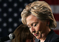 Sen. Hillary Clinton pauses before delivering her concession speech following the Iowa caucuses in Des Moines, Iowa on January 3, 2008. In what many considered an upset, Clinton was defeated by Sen. Barack Obama.