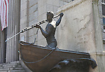 Sculpture of man with harpoon standing in a whaling boat. New Bedford, MA