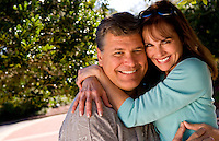 White attractive couple aged 50s at home snuggling and in love outdoors at home married