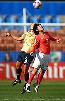 Eun Kyung Lee (KOR) and Amber Brooks (USA) compete for the ball..FIFA U17 Women's World Cup, USA v Korea Republic, Waikato Stadium, Hamilton, New Zealand, Sunday 9 November 2008. Photo: Renee McKay/PHOTOSPORT