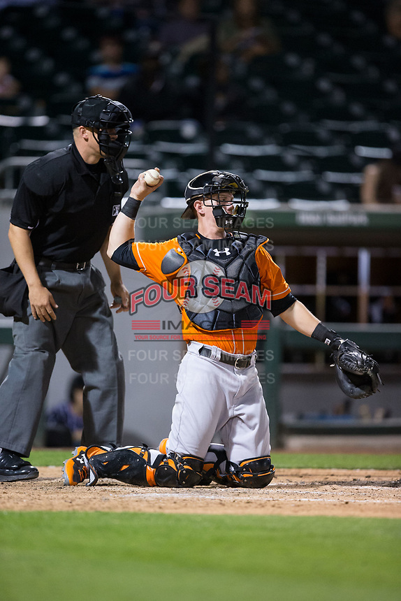 Norfolk Tides catcher Chance Sisco (23) throws the ball back to his pitcher during the game against the Charlotte Knights at BB&T BallPark on May 2, 2017 in Charlotte, North Carolina.  The Knights defeated the Tides 8-3.  (Brian Westerholt/Four Seam Images)