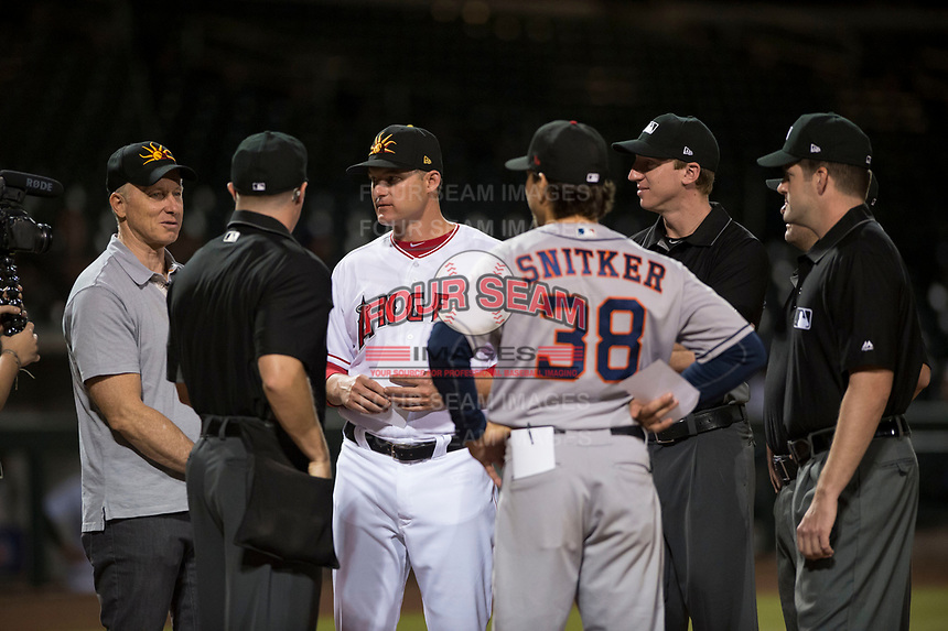 John Giles, the 40th Mayor of Mesa, meets with Mesa Solar Sox manager Lou Marson (4), Scottsdale Scorpions hitting coach Troy Snitker (38), and the umpire staff made up of Junior Valentine, John Bacon, Jeremy Riggs, and Alex Tosi before an Arizona Fall League game at Sloan Park on October 10, 2018 in Mesa, Arizona. Scottsdale defeated Mesa 10-3. (Zachary Lucy/Four Seam Images)