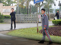 Security guards at Foshan Lighting Co Ltd, Guangdong, Gaoming District, Foshan China.  The factory, in which German company Osram has invested, has over 100 workers poisened with mercury vaporwhile making low energy lightbulbs.<br /> <br /> PHOTO BY RICHARD JONES/SINOPIX