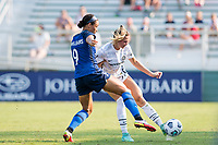 CARY, NC - SEPTEMBER 12: Kelli Hubly #20 of the Portland Thorns clears the ball away from Lynn Williams #9 of the NC Courage during a game between Portland Thorns FC and North Carolina Courage at WakeMed Soccer Park on September 12, 2021 in Cary, North Carolina.