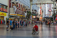 Las Vegas, Nevada.  Fremont Street, Two Street Performers Beginning to Assemble a Crowd.
