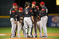 Richmond Flying Squirrels manager Jose Alguacil (13) makes a pitching change with (L-R) Myles Schroder, Rando Moreno, Kelby Tomlinson, Jackson Williams (8), Josh Osich and Ricky Oropesa (hidden) during a game against the Erie Seawolves on May 19, 2015 at Jerry Uht Park in Erie, Pennsylvania.  Richmond defeated Erie 8-5.  (Mike Janes/Four Seam Images)