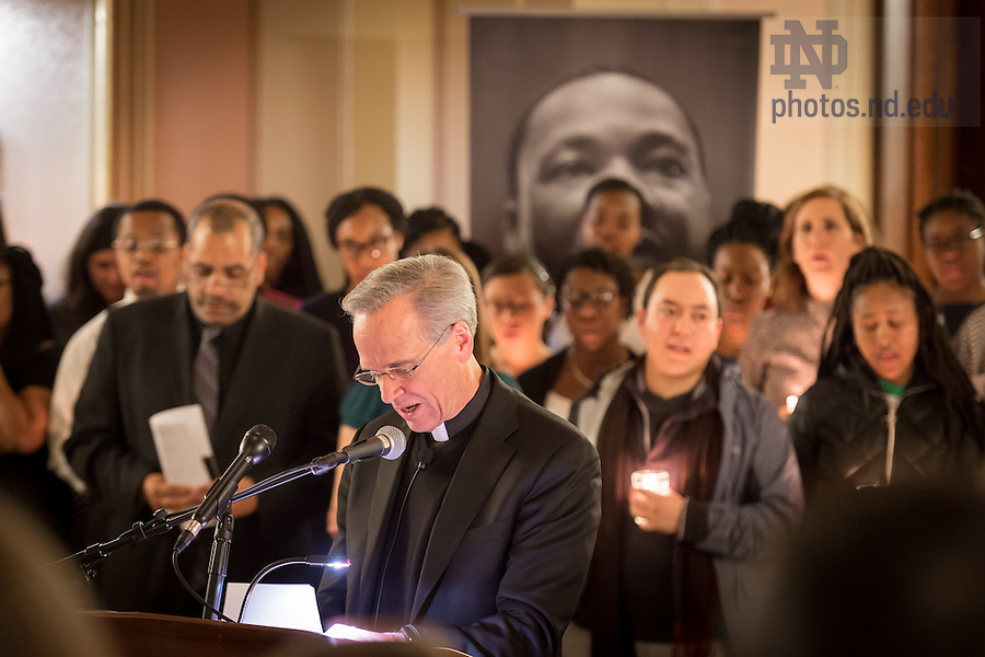 """January 16, 2017; Notre Dame President Rev. John I. Jenkins, C.S.C. leads The Lord's Prayer during a candlelight prayer service in the Main Building in observation of Martin Luther King Jr. Day. The event also marked the beginning of """"Walk the Walk"""" week, a series of events an observances to celebrate and reflect on diversity and inclusiveness. (Photo by Matt Cashore/University of Notre Dame)"""