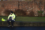 Motherwell 3 Dundee 1, 12/12/2015. Fir Park, Scottish Premiership. A programme seller waiting for customers in a street next to Fir Park, home to Motherwell Football Club, before they played Dundee in a Scottish Premiership fixture. Formed in 1886, the  home side has played at Fir Park since 1895. Motherwell won the match by three goals to one, watched by a crowd of 3512 spectators. Photo by Colin McPherson.