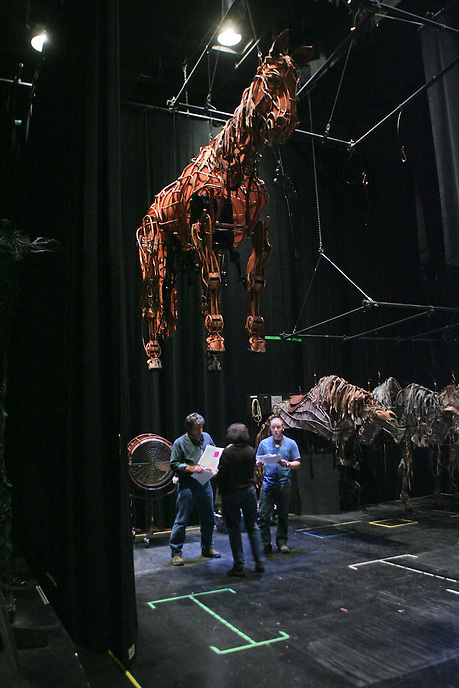 """Backstage pre-show preparation by technical crew at The National Theatre production of """"War Horse"""", a blend of storytelling and puppetry set during Britain's entry into the first World War.  Vivian Beaumont Theater.  Photo by Ari Mintz.  3/25/2011."""