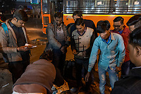 People gather around market vendors in a small market near the Chadni Chowk Yellow Line subway station in Delhi, India, on Tue., Dec. 11, 2018.