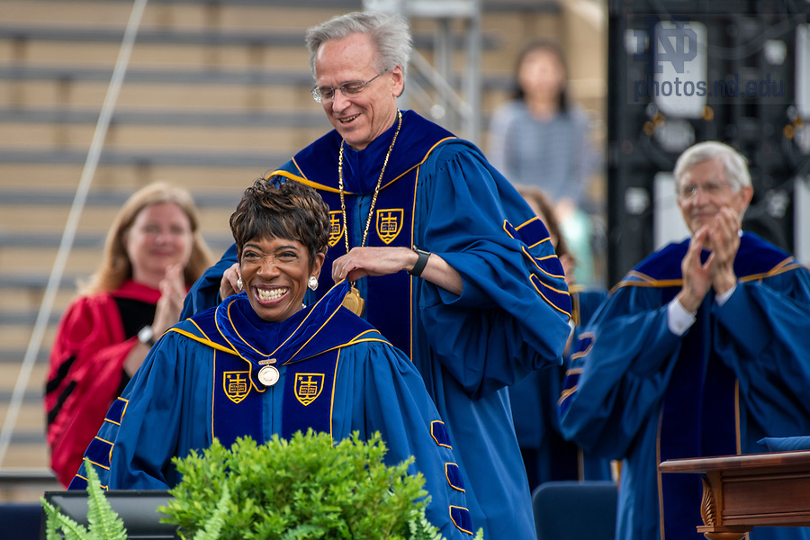 May 23, 2021;  Carla Harris receives the Laetare Medal from University of Notre Dame President John I. Jenkins, C.S.C., during the 176th Commencement Ceremony at Notre Dame Stadium. (Photo by Barbara Johnston/University of Notre Dame)