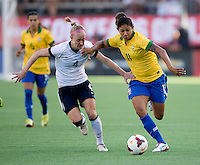 Becky Sauerbrunn (4) of the USWNT fights for the ball with Cristiane (11) of Brazil during an international friendly at the Florida Citrus Bowl in Orlando, FL.  The USWNT defeated Brazil, 4-1.