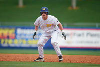 Michigan Wolverines first baseman Jesse Franklin (7) leads off first base during a game against Army West Point on February 18, 2018 at Tradition Field in St. Lucie, Florida.  Michigan defeated Army 7-3.  (Mike Janes/Four Seam Images)