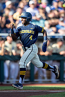 Michigan Wolverines second baseman Ako Thomas (4) scores a run in the first inning against the Vanderbilt Commodores during Game 3 of the NCAA College World Series Finals on June 26, 2019 at TD Ameritrade Park in Omaha, Nebraska. Vanderbilt defeated Michigan 8-2 to win the National Championship. (Andrew Woolley/Four Seam Images)