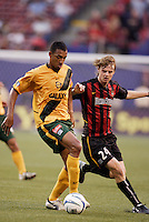 The Galaxy's Tyrone Marshall is marked by the MetroStars' Eddie Gaven. The NY/NJ MetroStars defeated the LA Galaxy 3 to 0 during MLS action at Giant's Stadium, East Rutherford, NJ, on August 8, 2004.