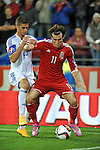 UEFA European Championship at Cardiff City Stadium - Wales v Cyprus : Gareth Bale of Wales is challenged by Pieros Sotiriou of Cyprus