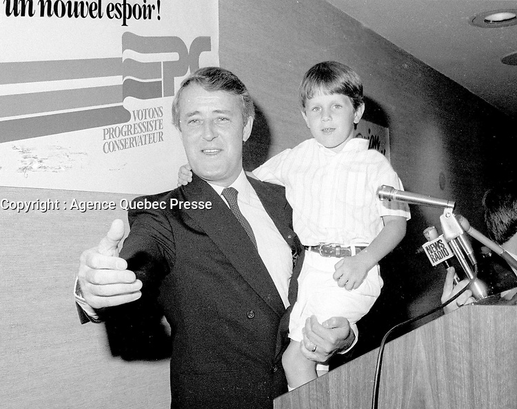 Dorval (Qc) CANADA - July 15, 1984 File Photo-<br /> <br /> Brian Mulroney  leader of  Progressive-Conservative  Party held one of  his sons at the presentation of Montreal's PC Candidates in the 1984 federal election.
