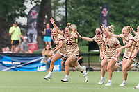 NEWTON, MA - MAY 22: Cara Urbank #26 of Boston College celebrates victory with her teammates after NCAA Division I Women's Lacrosse Tournament quarterfinal round game between Notre Dame and Boston College at Newton Campus Lacrosse Field on May 22, 2021 in Newton, Massachusetts.