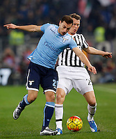 Calcio, Serie A: Lazio vs Juventus. Roma, stadio Olimpico, 4 dicembre 2015.<br /> Lazio's Stefan Radu, left, and Juventus' Stephan Lichsteiner fight for the ball during the Italian Serie A football match between Lazio and Juventus at Rome's Olympic stadium, 4 December 2015.<br /> UPDATE IMAGES PRESS/Riccardo De Luca