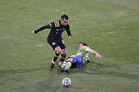 COLUMBUS, OH - DECEMBER 12: Lucas Zelarayan #10 of the Columbus Crew is challenged for the ball by Nicolas Lodeiro #10 of the Seattle Sounders FC during a game between Seattle Sounders FC and Columbus Crew at MAPFRE Stadium on December 12, 2020 in Columbus, Ohio.