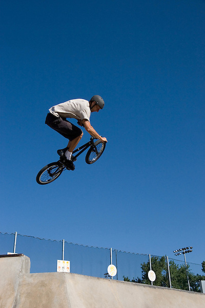 Caucasian male on a BMX bike in a skateboard park, Boulder, Colorado, USA .  John offers private photo tours in Denver, Boulder and throughout Colorado. Year-round.