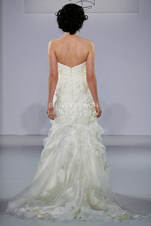 Model walks runway in a Swept Away wedding dress from the Matty by Matthew Christopher Spring 2013 collection, at the Couture Show, during New York Bridal Fashion Week Spring 2013.