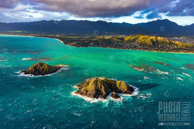 Morning light over the Mokulua Islands off of Lanikai and Kailua, with the Ko'olau Range in the distance, Windward O'ahu.
