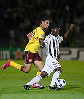 Fudbal, Champions league,Group H season 2010/2011.Partizan Vs. Arsenal.Mohamed Kamara Medo, right and Marouane Chamakh.Beograd, 29.09.2010..foto: Srdjan Stevanovic/Starsportphoto ©
