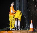 © Joel Goodman - 07973 332324 . 27/12/2015 . Wigan , UK . A man rubs a woman's back as she vomits . Revellers in Wigan enjoy Boxing Day drinks and clubbing in Wigan Wallgate . In recent years a tradition has been established in which put on fancy dress for a Boxing Day night out . Photo credit : Joel Goodman